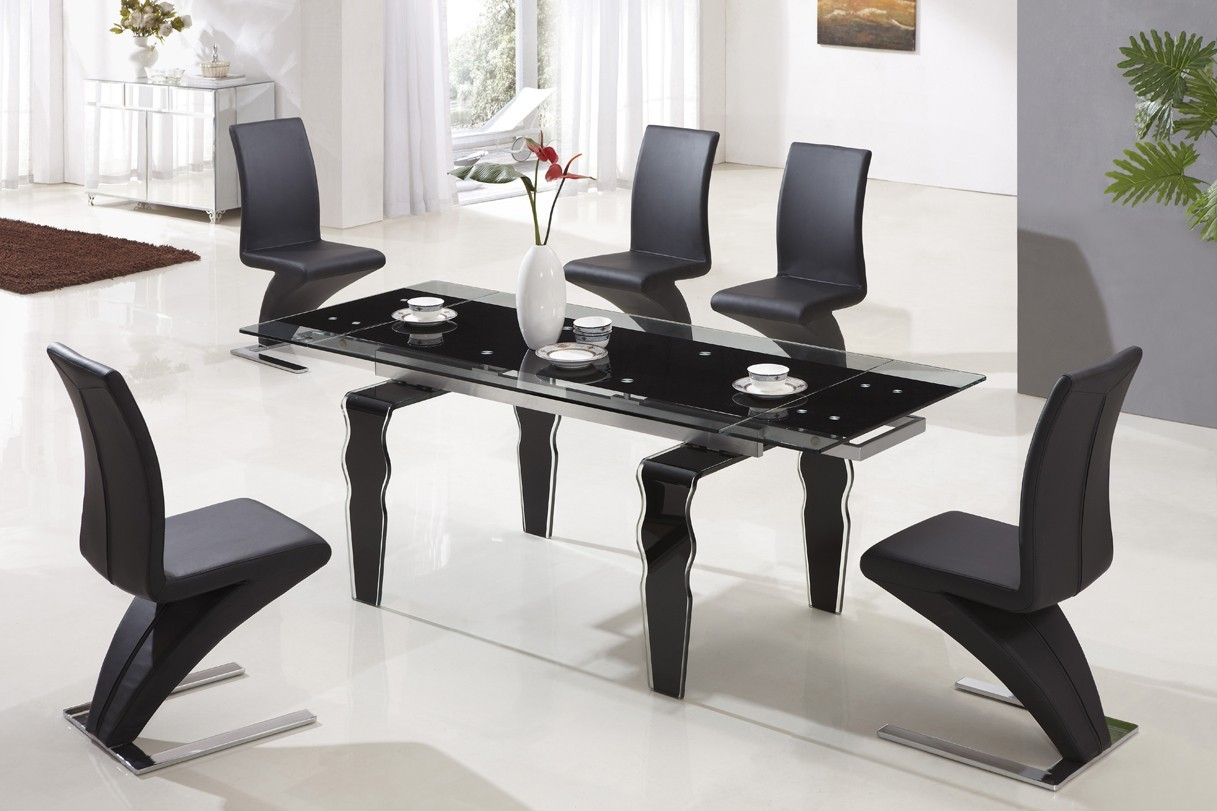 Designer extended tempered glass dining table with black z for Tempered glass dining table